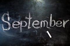 题字是9月1日 在黑板的白垩 图库摄影