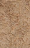 题字的片段在古希腊的在古老marbl 库存照片