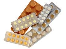 颜色不同的药物堆范围 库存图片