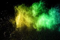 颜色在黑背景的粉末爆炸 库存照片