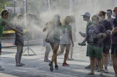 颜色奔跑的赛跑者和职员 库存照片