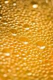 颜色桔子waterdrops 免版税库存图片