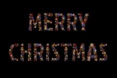 颜色烟花点燃形成圣诞快乐词 库存图片