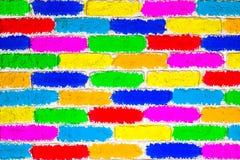 颜色砖被绘的墙壁  图库摄影