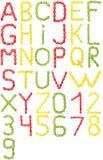 颜色糖果的充分的英语字母表和数字 免版税库存图片