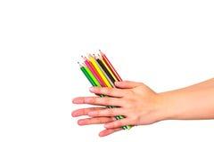 颜色铅笔在手边 图库摄影