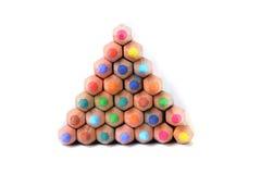 颜色铅笔金字塔在白色的 免版税库存照片