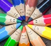 颜色铅笔andFace有许多emotio 免版税库存照片