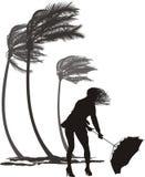 风和树棕榈的女性 免版税库存照片