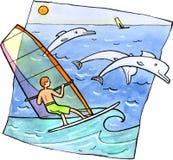 风帆冲浪与海豚 免版税图库摄影