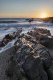 风平浪静的美好的充满活力的日落风景图象反对大鹏的 库存照片