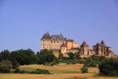 风景chateau de biron,多尔多涅省法国 免版税库存图片