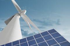 风车和太阳能电池反对光滑的多云天空 库存图片