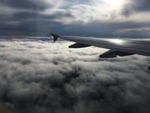 飞机翼视图在云彩的 免版税图库摄影
