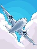 飞机飞行通过多云天空 库存照片