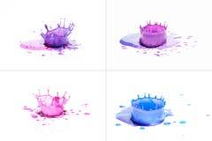 飞溅在白色的蓝色和紫色油漆 库存照片