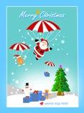 飞行与在天空的降伞的圣诞老人项目和朋友 皇族释放例证