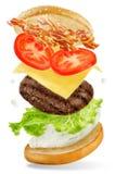 飞行与蛋黄酱splat的肉汉堡 免版税库存图片