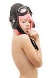 飞行员盔甲的露胸部的桃红色头发女孩 图库摄影