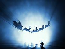 飞行圣诞老人爬犁 库存照片