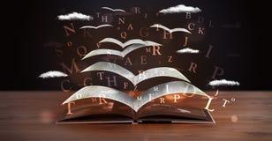 飞行在书外面的页和发光的信件 免版税库存图片