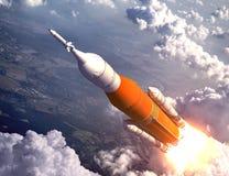 飞行在云彩的美国空间发射系统 免版税库存照片