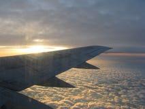 飞行在云彩 图库摄影