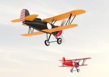 飞行在天空的两架双翼飞机 库存照片