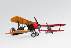 飞行在天空的两架双翼飞机 免版税库存照片