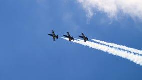 飞行在小组的四架军用飞机 免版税图库摄影