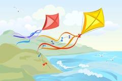 飞行在海的风筝 免版税库存照片