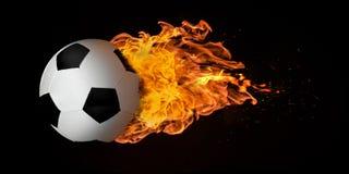 飞行在火焰吞噬的橄榄球或足球 免版税库存照片