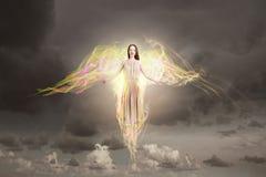 飞行天使的女孩高 库存图片