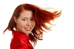 飞行头发她让的红色妇女 库存图片