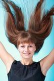 飞行头发妇女 库存照片