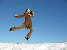飞行女孩跳冬天 免版税库存图片