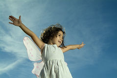 飞行女孩年轻人 库存图片