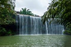 飞行瀑布在竹海域竹森林里  免版税库存照片