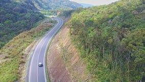 飞行照相机移动在山路在驾驶汽车以后 影视素材