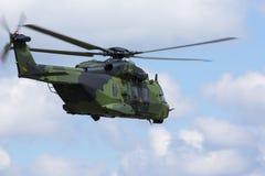 飞行现代作战的直升机  免版税库存照片