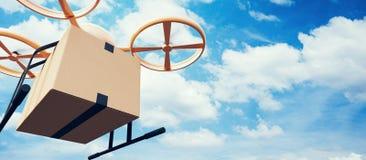 飞行空的工艺箱子的照片黄色普通设计现代遥控空气寄生虫在都市表面下 蓝色覆盖天空 免版税图库摄影