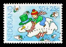 飞行雪人的男孩,孩子盖印-年残疾 免版税库存图片