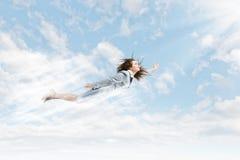 飞行非凡的女性 库存图片