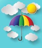 飞行高在天空中的五颜六色的伞 免版税库存照片