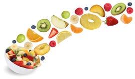 飞行水果沙拉拼贴画用果子喜欢苹果,桔子, 免版税库存照片