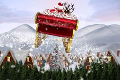 飞行他的雪橇的圣诞老人的综合图象 库存图片