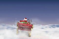 飞行他的雪橇的圣诞老人的综合图象 免版税库存照片
