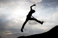 飞跃成功 库存图片