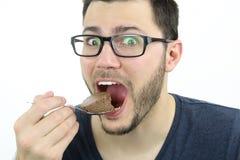 食人的巧克力沫丝淋 免版税库存图片