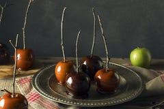 食家甜花梢苹果糖 库存图片